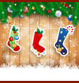 christmas stocking on wooden background vector image vector image