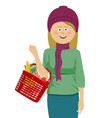 young woman holding shopping basket vector image