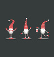 cute gnomes in red santa hats on black background vector image vector image