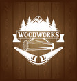woodworks label with wood log and saw emblem for vector image vector image