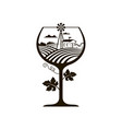 wine glass with vineyard fields vector image