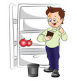 excited man with ice cream cup next to a fridge vector image