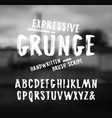 handwritten brush font in grunge style vector image