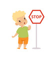 cute boy showing stop gesture while standing next vector image vector image