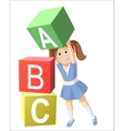 Smiling little girl studying the alphabet vector image