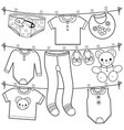 baby clothes hanging on clothes line vector image