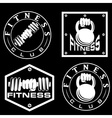 Hand holding barbell and kettlebell in emblems
