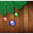 Christmas wooden background with red ball vector image vector image