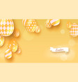 easter background with realistic yellow eggs vector image