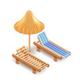 Beach umbrella and deck chair isolated on white