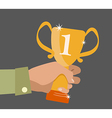 Flat design concept icon of winner cup in hand vector image