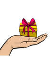 pop art man hand hold gift box ribbon vector image