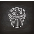 cupcake sketch on chalkboard vector image vector image