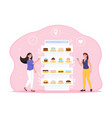 two female characters are ordering cakes online vector image