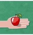 hand gives a red apple vector image