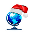 globe on stand in a hat santa claus on a white vector image vector image