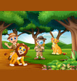 cartoon of two boy explorer with animals in the ju vector image vector image