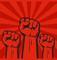 three clenched fists on red grunge background with vector image vector image