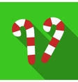 Christmas candy cane with stripes icon flat style vector image vector image