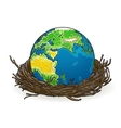 small model of earth in a birds nest vector image