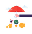 insurance agent holding umbrella over money vector image vector image