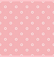 seamless pattern with white polka dots on a pink vector image
