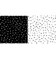 set irregular black and white dots pattern vector image