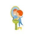 little boy standing on chair in front of bathroom vector image