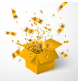 open yellow gift box and gold confetti christmas vector image