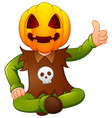 happy kid wearing pumpkin mask giving thumb up vector image vector image