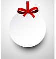 White paper gift card with red satin bow vector image