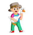 a farm boy holding a goose vector image vector image