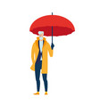 an elderly man in a yellow cloak with an umbrella vector image vector image