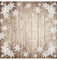 Snowflakes on the wooden board vector image vector image