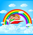 happy kids flying on big open book with rainbow vector image