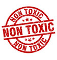 non toxic round red grunge stamp vector image vector image