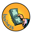 business hand with money dollars icon symbol vector image vector image
