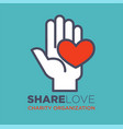 hand and heart social love and charity vector image vector image