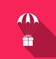 gift box flying on parachute icon with long shadow vector image vector image