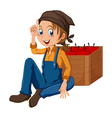 A young gardener sitting beside the box vector image vector image
