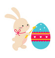 cute little bunny holding huge colorful decorated vector image vector image