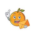 orange fruit cartoon character with envelope vector image vector image