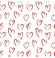 seamless pattern with red hearts drawn of brush vector image