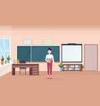 woman teacher standing in modern school classroom vector image vector image
