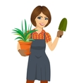 woman holding green Chlorophytum plant in pot vector image vector image