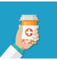 medicine bottle with red cross in hand of a doctor vector image vector image
