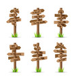 Wooden arrow signboards direction set