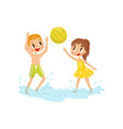 two little kids playing in water with inflatable vector image