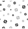 cat and dog footprints seamless pattern pets or vector image vector image