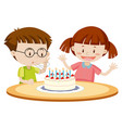 kids blowing cake on birthday vector image vector image
